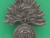 KK 2213, Royal Fusiliers 1942 bakelite badge, 38 x 49mm. A. Stanley & Sons.