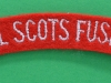 The Royal Scots Fusiliers cloth shoulder title.