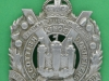 KK 628. Kings Own Scottish Borderers. Small curvet badge. 46x65 mm.