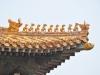 Taget på Kejserens palads i Den Forbudte By med kejsernes symbol fabeldyret der er sammensat af en løve, en hjort og en fisk, med 10 stk som er det højeste.