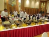 Velkomstparty i Dalian. Et langt bord fyldt med alskens gode sager på et fem stjernet hotel.