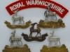 The Royal Warwickshire Regiment badges.