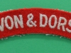 Devon & Dorset Regiment cloth shoulder title. 115x20 mm.