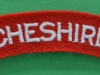 The Cheshire Regiment cloth shoulder title.