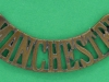 RW1306. 1902 The Manchester Regiment shoulder title. 12x55 mm.