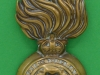 KK 947, The Royal Fusiliers grenade badge, brass, replaced fastings. 39 x 89mm.