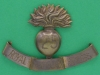 KK 1142, 25th Battalion Royal Frontiersmen Fusiliers, City of London Regiment, 80 x 56mm. Was made in a local garage, adding a hand engraved sheetbrass scroll to a Grenadier Guards badge.