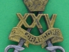 KK 1915. 25th Dragoons 1941. Local made, long lugs. 28x35 mm.