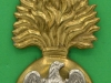 KK 970. Royal Irish Fusiliers, piper badge. Lugs 42x91 mm.