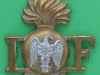 RW1401. Royal Irish Fusiliers shoulder title badge 1938. 32x36 mm.