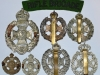The Rifle Brigade group badges reverse.