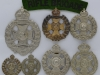 The Rifle Brigade group badges.
