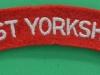 West Yorkshire Regiment cloth shoulder title.