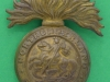 KK 593. Northumberland Fusiliers. 1916 all brass cap badge. Slide 34x41 mm.