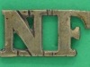 RW759. Northumberland Fusiliers. first shoulder title pre 1910. 24x13 mm.