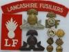 The Lancashire Fusiliers badges.