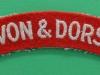 Devon & Dorset Regiment cloth shoulder title. 115x20 mm.