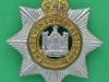 KK 602. The Devonshire Regiment. Slide lavtsiddende krone 41x43 mm.