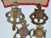 The Royal Sussex Regiment badges, reverse