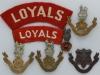 The Loyal North Lancashire Regiment badge group.