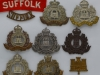 The Suffolk Regiment badge group.
