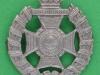 KK 2421. 17th London Tower Hamlets Rifles. Small beret badge 28x32 mm.