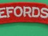 Herefordshire Regiment cloth shoulder title.