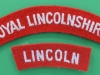 The Lincolnshire Regiment cloth shoulder titles.