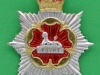 Gaylor 49. Gloucestershire & Hampshire Regiment officers cap badge. It was made official, but never issued. Long lugs 41x53 mm.