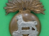 KK 701. The Royal Munster Fusiliers. Slide & brace holes. 33x41 mm.