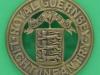 KK 355. The Royal Guernsey Militia, helmet plate badge. 49 mm.