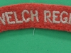 The Welch Regiment cloth shoulder title. 125x20 mm.